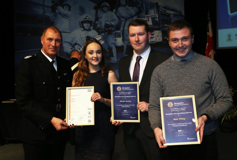 Assistant Chief Fire Officer Dave Myers presents achievers' awards to apprentices Emily Hodson, Deryn Jones and Matt Titley (right)