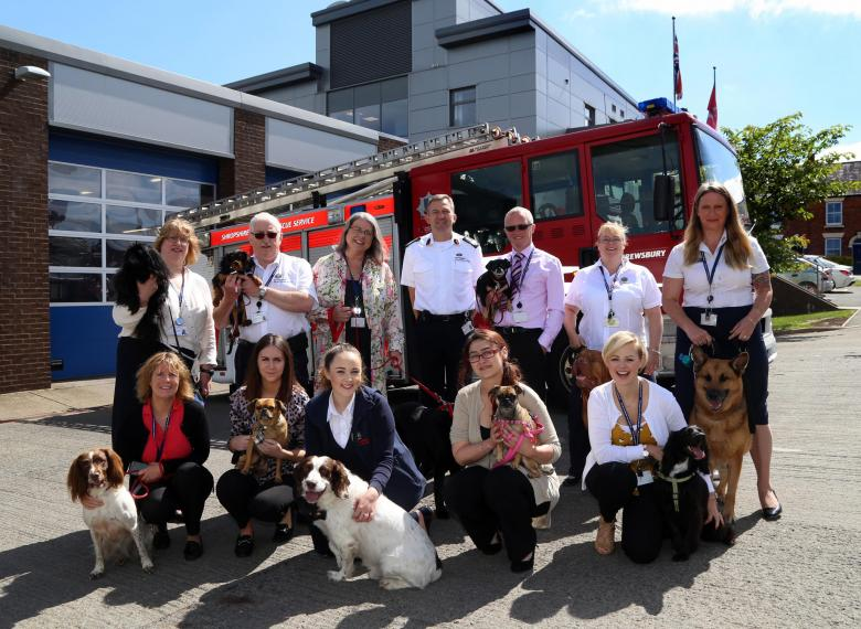 Staff with their pets at Shrewsbury fire HQ as part of the annual Bring Your Dog to Work Day. Pictured with Chief Fire Officer Rod Hammerton