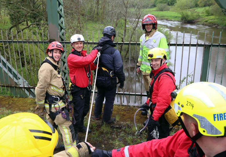 Firefighters from Shropshire Fire and Rescue Service and Hereford and Worcester Fire and Rescue Service prepare to hook up a police negotiator in a training exercise on a bridge over the River Severn. Left to right Telford firefighter Jordan Bixley, Saul Bolton and right, Telford Crew Manager Dave Joiner and Jamie Skipworth.