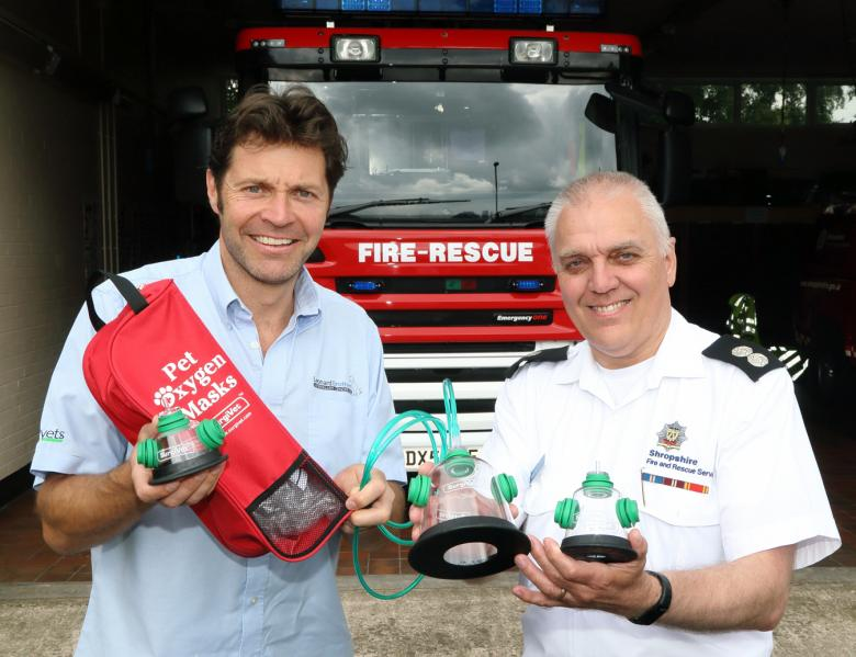 Whitchurch vet Steve Leonard hands over a pet oxygen mask to Martin Huckle at Whitchurch Fire Station as part of the life saving pets campaign.