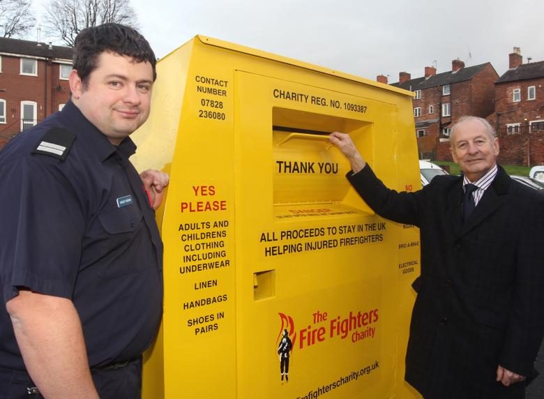 Charity Service Co-ordinator Ashley Brown (left) and Shropshire and Wrekin Fire Authority chairman Stuart West at one of the textile recycling banks at 17 Shropshire fire stations which have raised more than £6,000  for the Fire Fighters' Charity.