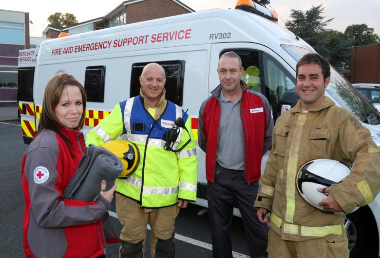 Shropshire fire and rescue officers with Red Cross volunteers