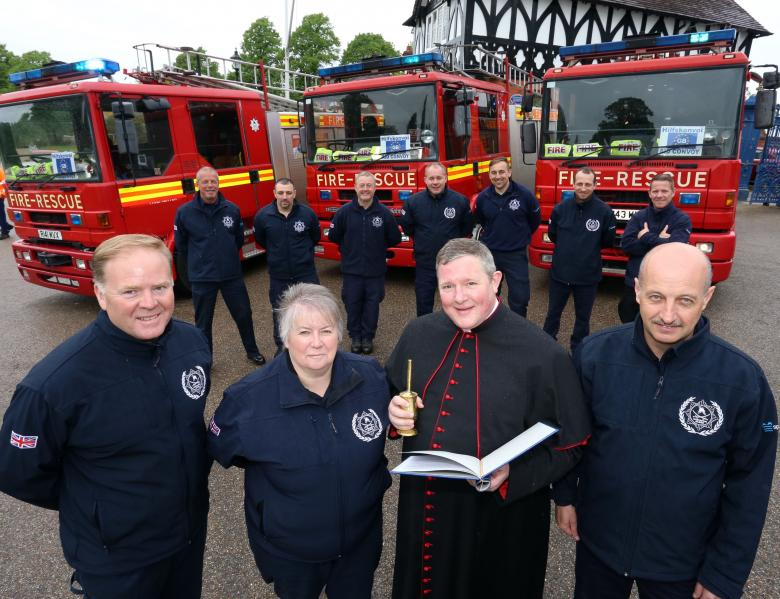 Volunteers got a traditional blessing in Shrewsbury Quarry from Shrewsbury Cathedral's Very Reverend Canon Jonathan Mitchell before setting off on a 12th humanitarian fire aid mission to Transylvania.