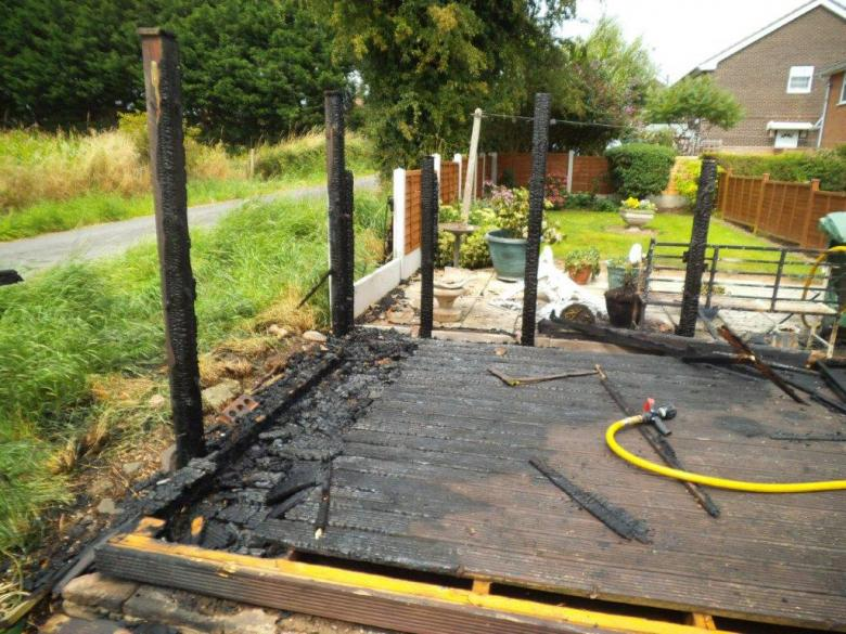 A pensioner suffered smoke inhalation when using a hosepipe to fight a fire in her garden caused by a gas burner in Hanwood, near Shrewsbury in Shropshire.