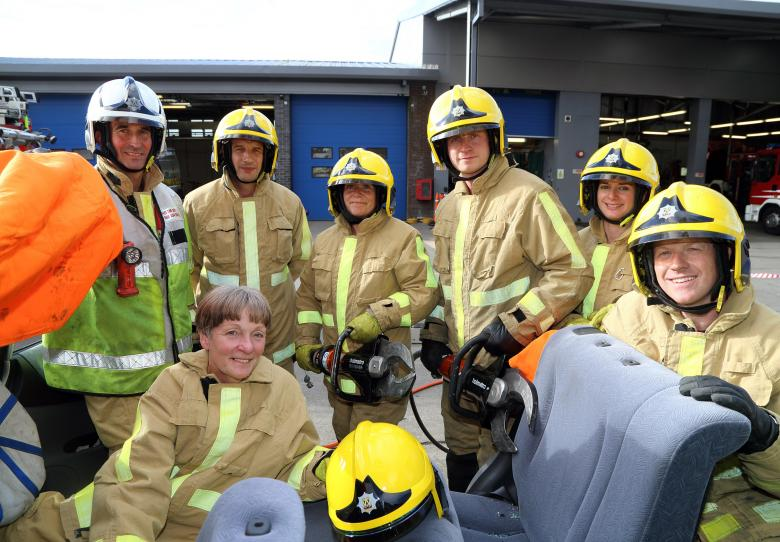 "In the ""hot seat"" is Shropshire's High Sheriff Christine Holmes (below left) after being cut free from a car by firefighters from Shrewsbury's Green Watch who train regularly to rescue county road crash victims. L to r: Watch Manager Alex Howell with firefighters Geraint Lewis, Bev Morris, Steve Mason, Kate White and Mitch Thorne at Shrewsbury fire HQ."