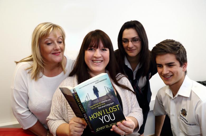 Fire service colleagues take a peek at Jenny Blackhurst's debut novel: left to right Maxine Titley, Jenny, Rachel Harrison and Dan Adams
