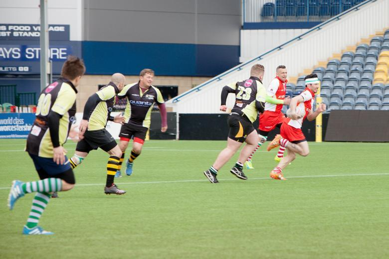 Bridgnorth firefighter Luke Veal (green sleeves) in last year's record rugby attempt