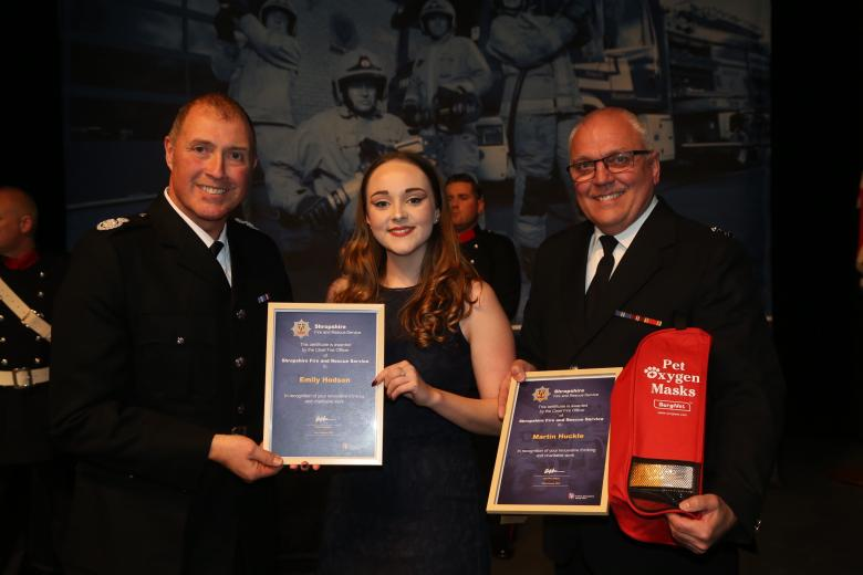 Watch Manager Martin Huckle and Technical Support Officer Emily Hodson receive an award from Shropshire's Assistant Chief Fire Officer Dave Myers for raising funds for pet oxygen masks for firefighters.