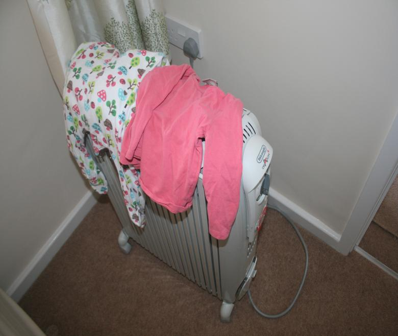 Drying clothes on a portable heater is a fire hazard