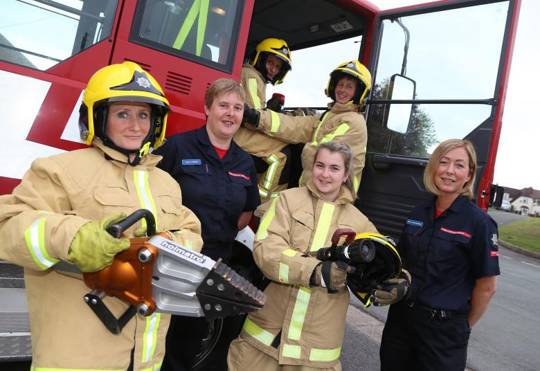 Firefighters Sally Eynon and Ruth Walkerdine at the taster day with women who want to be firefighters. Left to right: Helena Heath and Gemma Higgins with Julie Collins in the cab and Pam Neill.