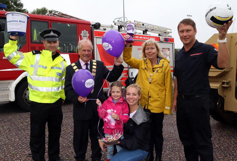 Shrewsbury Charity Fun Day, left to right, police officer Marv Choudhury, Mayor and Mayoress of Shrewsbury Peter and Julie Nutting with firefighter Andy Davies. Front are Anna Rouse and daughter Beau Kelly (age 5).